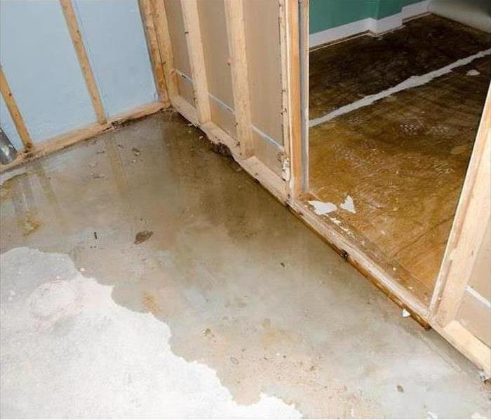 A room with standing water on the concrete floor