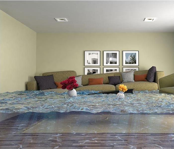 Living room with tan couches floating in a pool of water