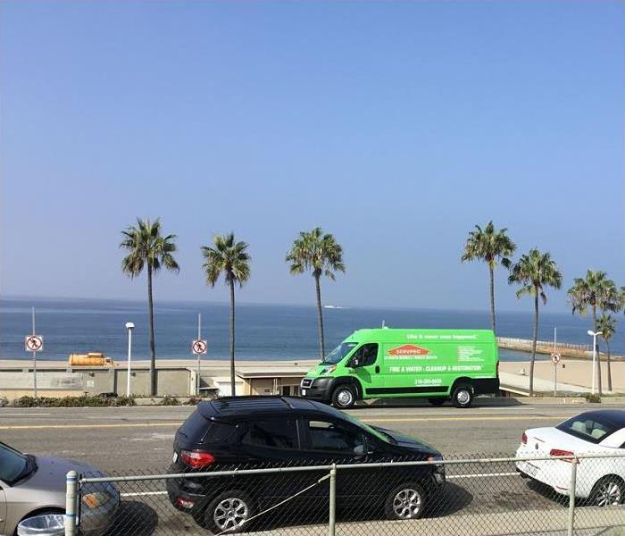 SERVPRO vehicle parked in front of beach