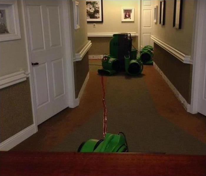SERVPRO drying equipment in hallway